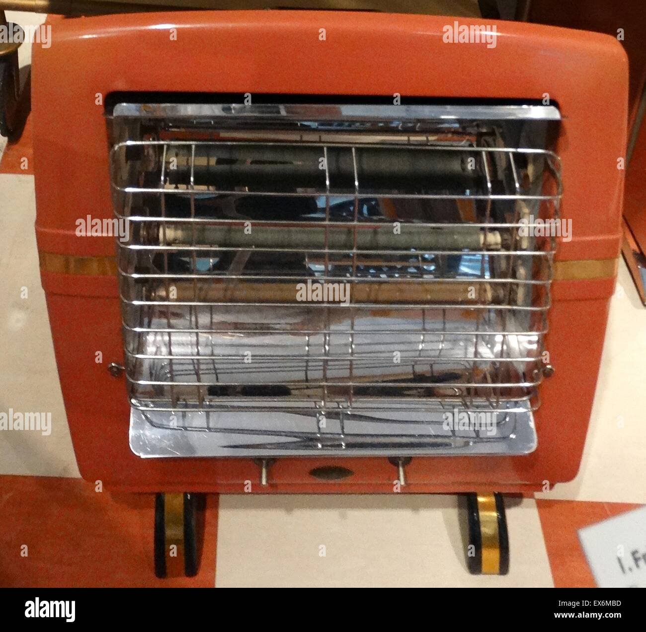 Orange electric fire from the 1950s. Dated 1955 - Stock Image