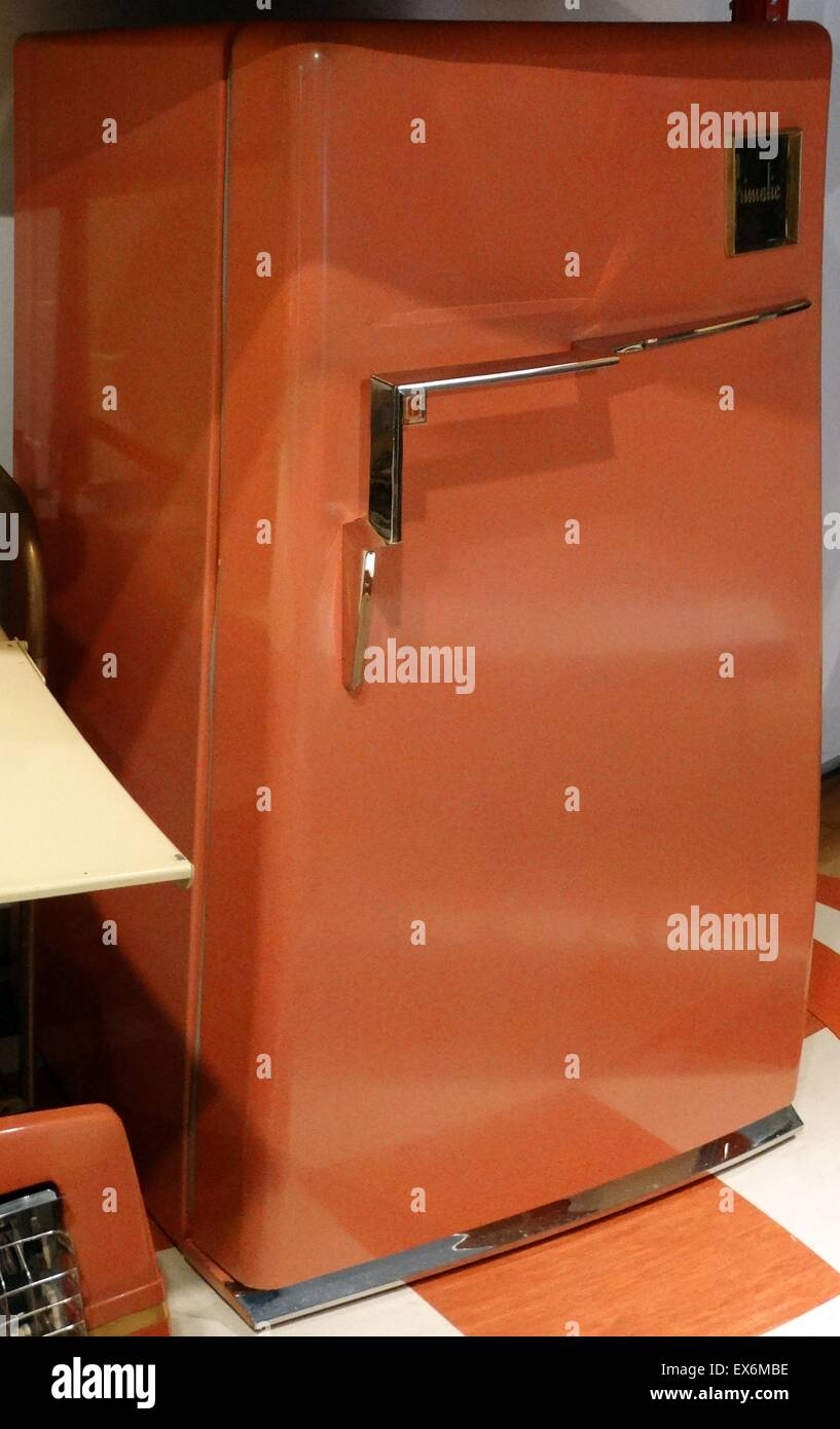 Orange fridge from the 1950s which is still in working order. Dated 1957 - Stock Image