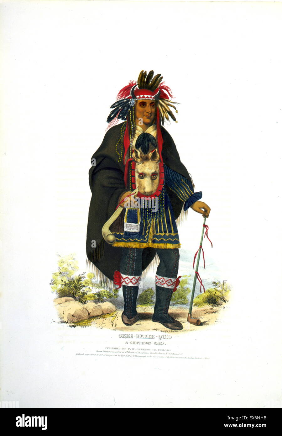 Okee-Makee-Quid a Chippewa chief wearing a buffalo headdress, holding a war club and a long peace pipe. The Ojibwe - Stock Image