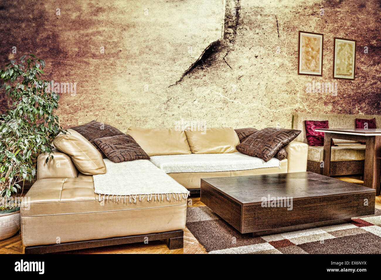Grunge living room or interior with dirty design with sofa corner grunge living room or interior with dirty design with sofa corner with cushions and low table concept of old warn wall in hom watchthetrailerfo