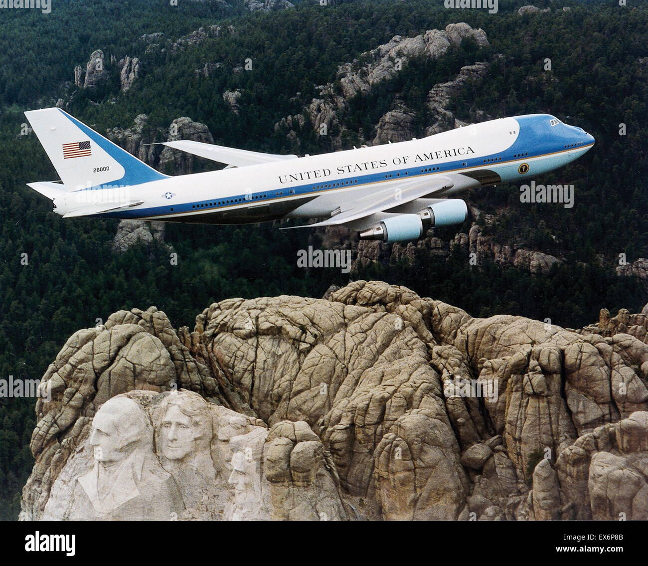 one of the two VC-25s used as Air Force One, flying over Mount Rushmore in February 2003. - Stock Image