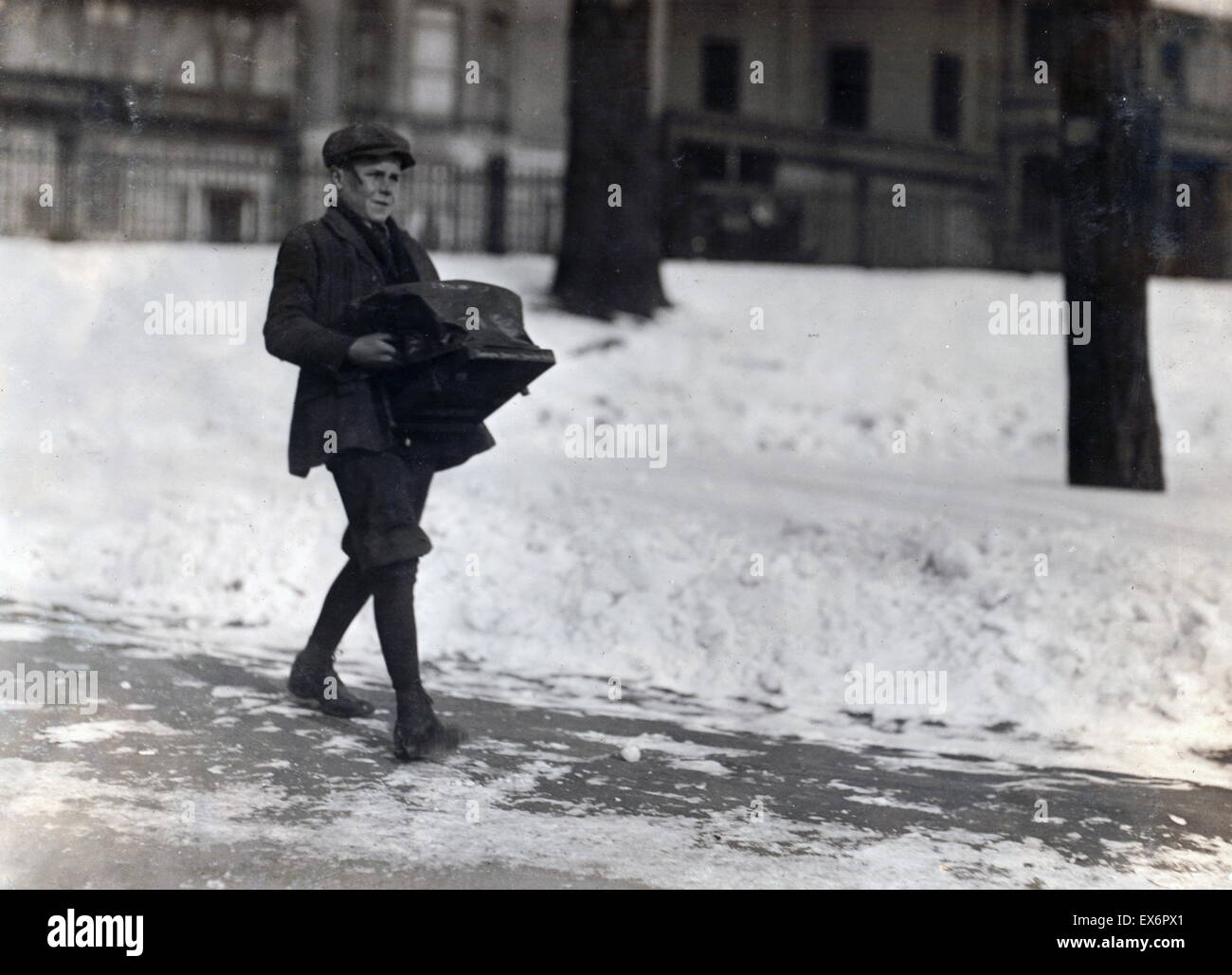 a sixteen year old boy delivering a heavy type-writer about half a mile, for Model Typewriter Inspection Co. . Taken - Stock Image