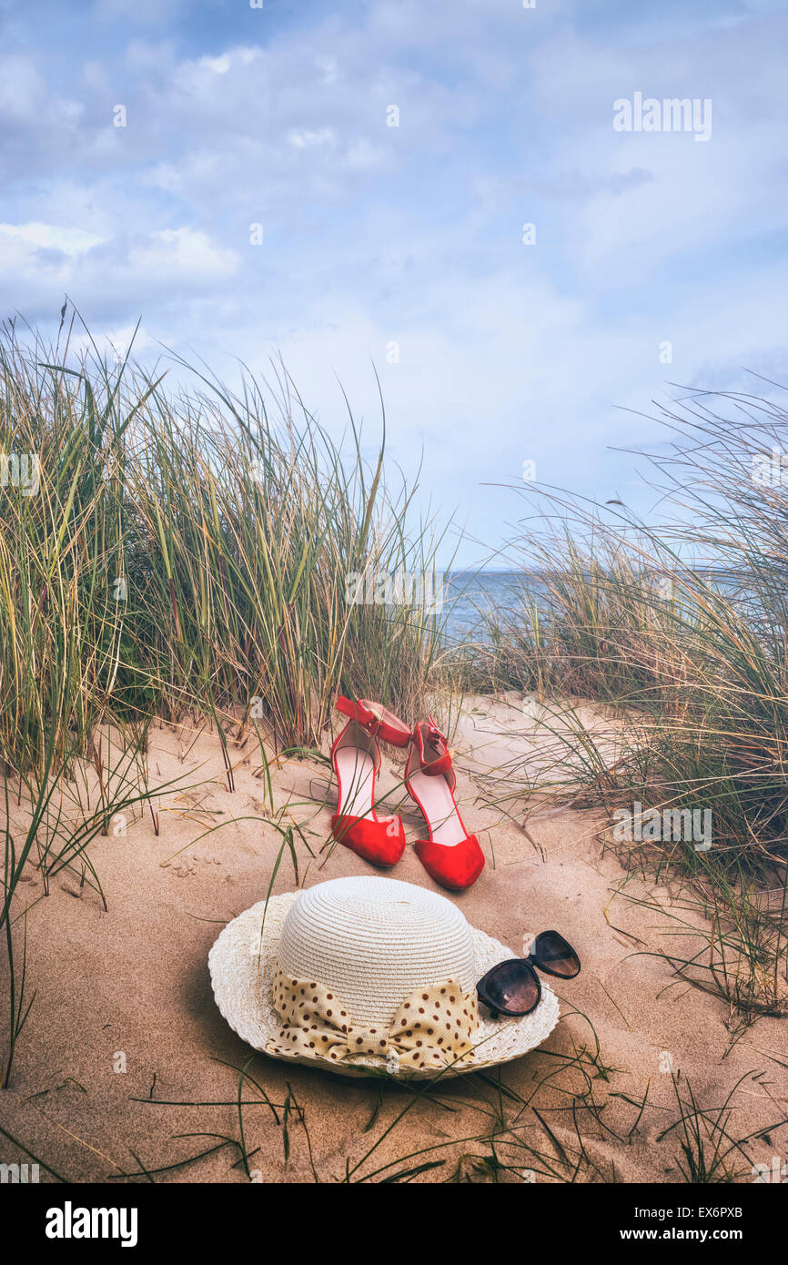 summer items in the dunes - Stock Image