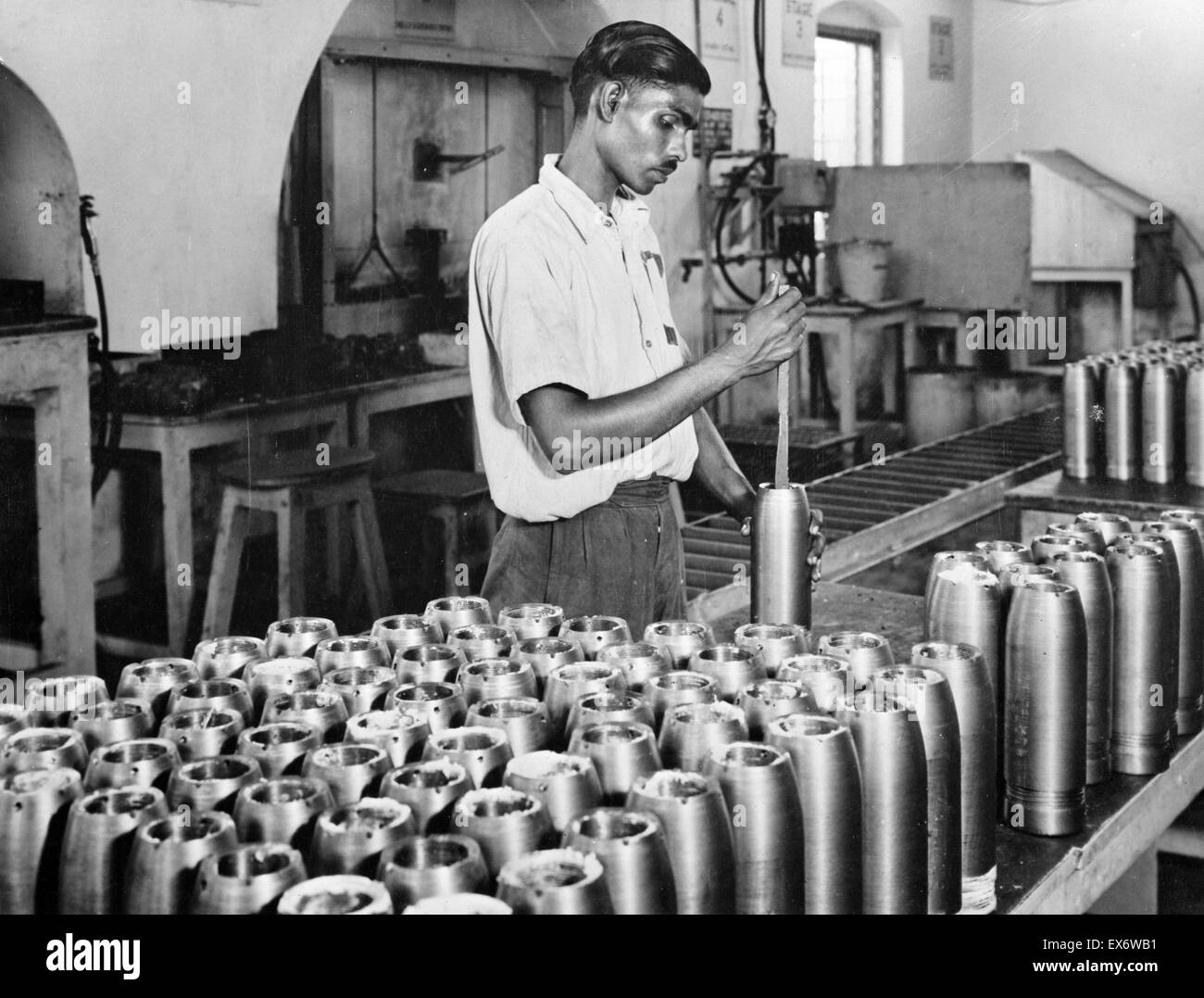 India in the war. A worker in one of India's fast expanding munitions plants. India produces more than 50 different - Stock Image