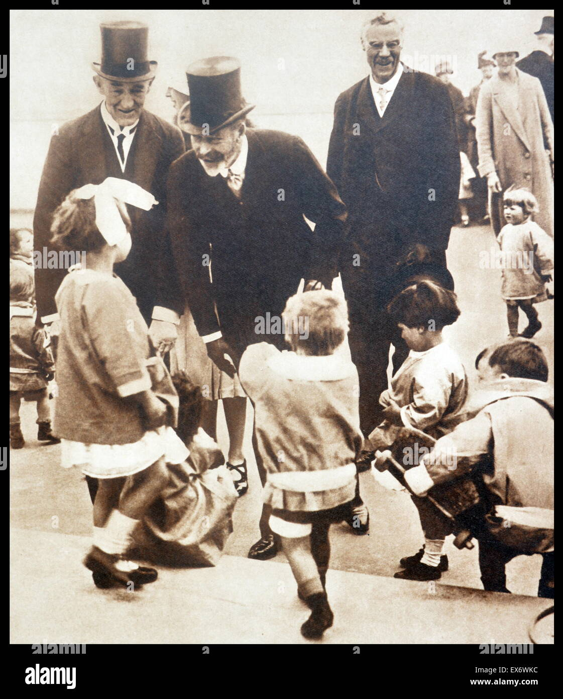 King George V of Great Britain receives good wishes from children 1930 - Stock Image