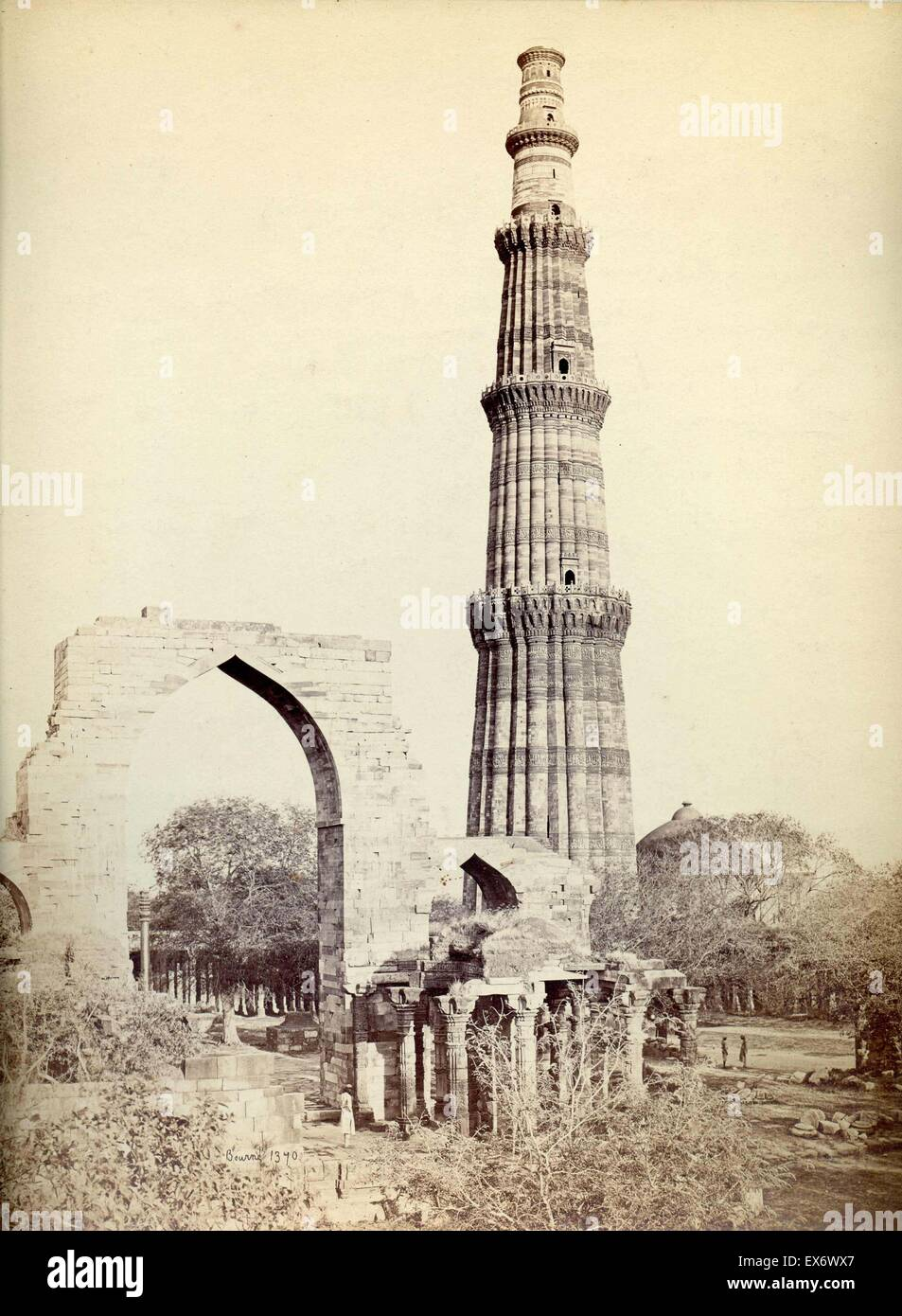 Qutb Minar in Delhi by Samuel Bourne (1834-1912). This fluted, red sandstone structure is the world's tallest - Stock Image