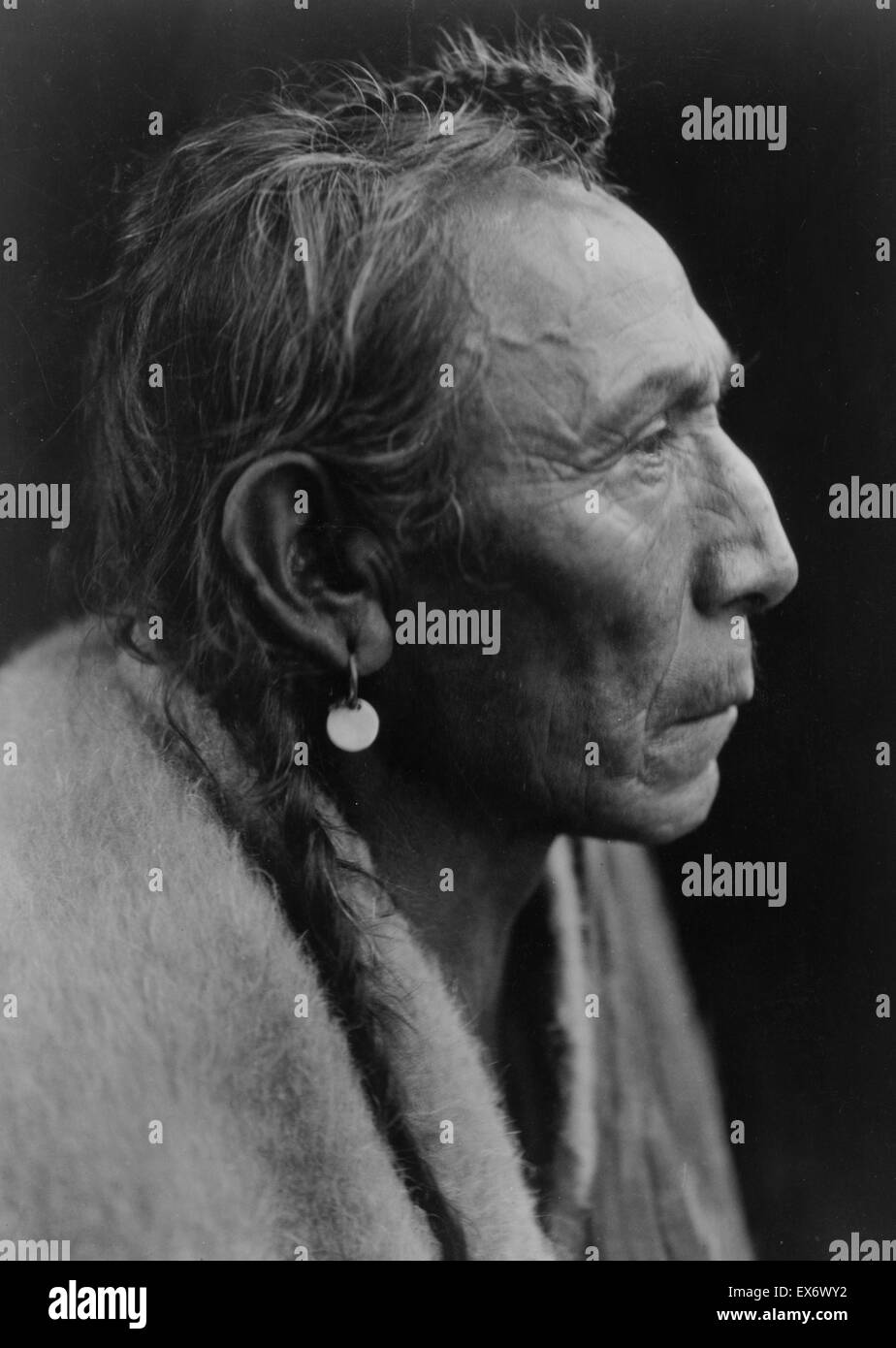 Photographic print of Aki-tanni Sarsi. Photographed by Edward S. Curtis (1868-1952) American ethnologist and photographer - Stock Image