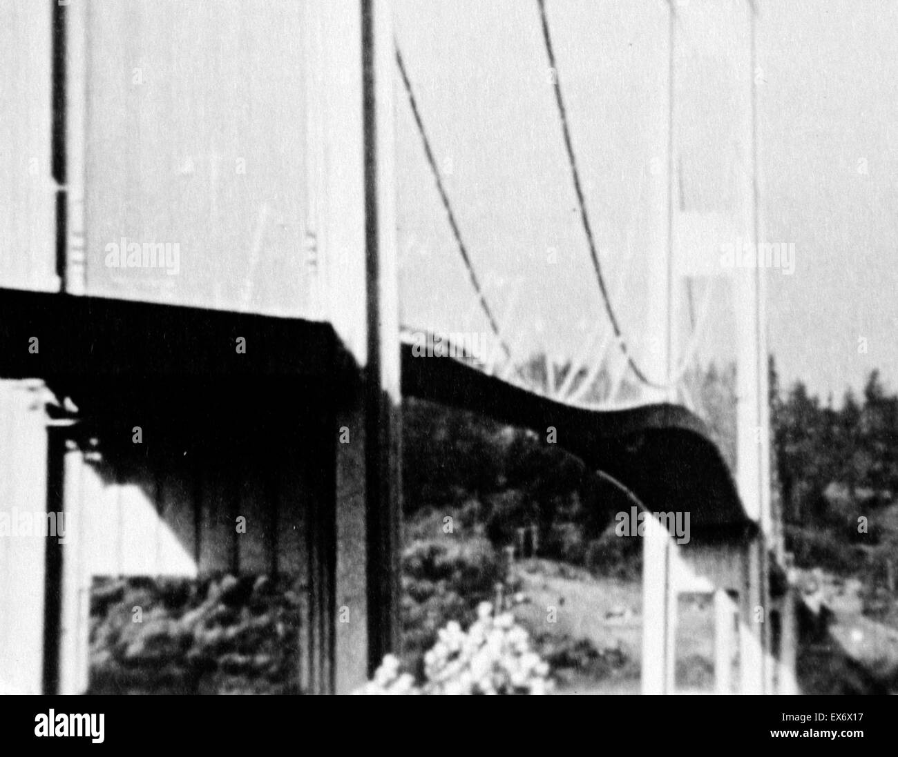 Photographic print of the original Tacoma Narrows Bridge before it's wind induced collapse. The print depicts - Stock Image