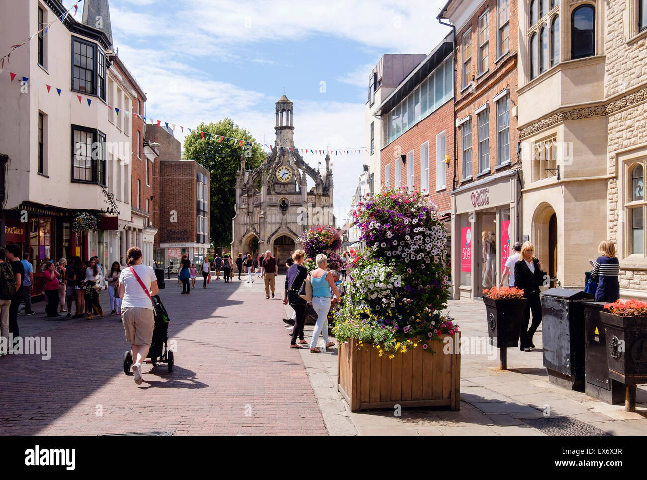 Street scene with view to old 16thc Market Cross with people shopping in Chichester city centre. East Street Chichester - Stock Image