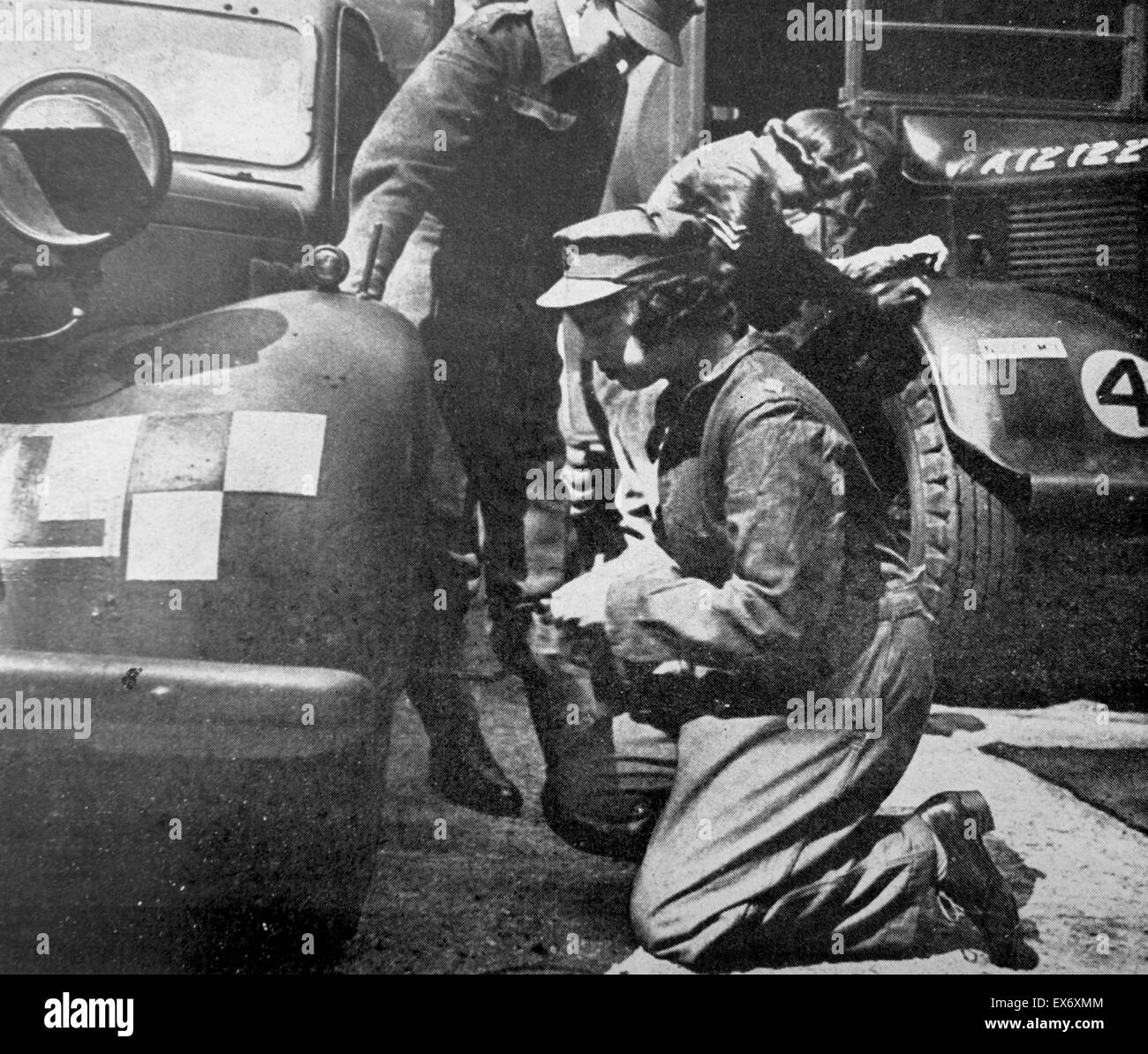 Princess (later Queen ) Elizabeth of Great Britain doing technical repair work during her World war two military - Stock Image