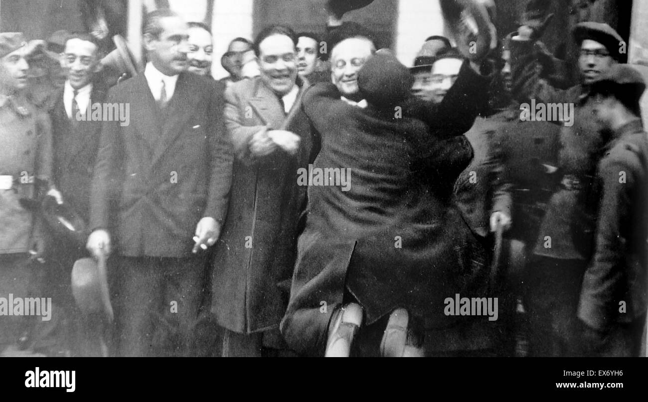 Miguel Maura Gamazo Centre with arm linked to Francisco Largo Caballero who is greeted by a supporter after the - Stock Image