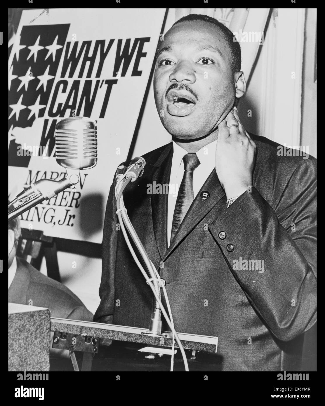 Martin Luther King, Jr. (1929-1968) three-quarter-length portrait, standing, face front, at a press conference. - Stock Image