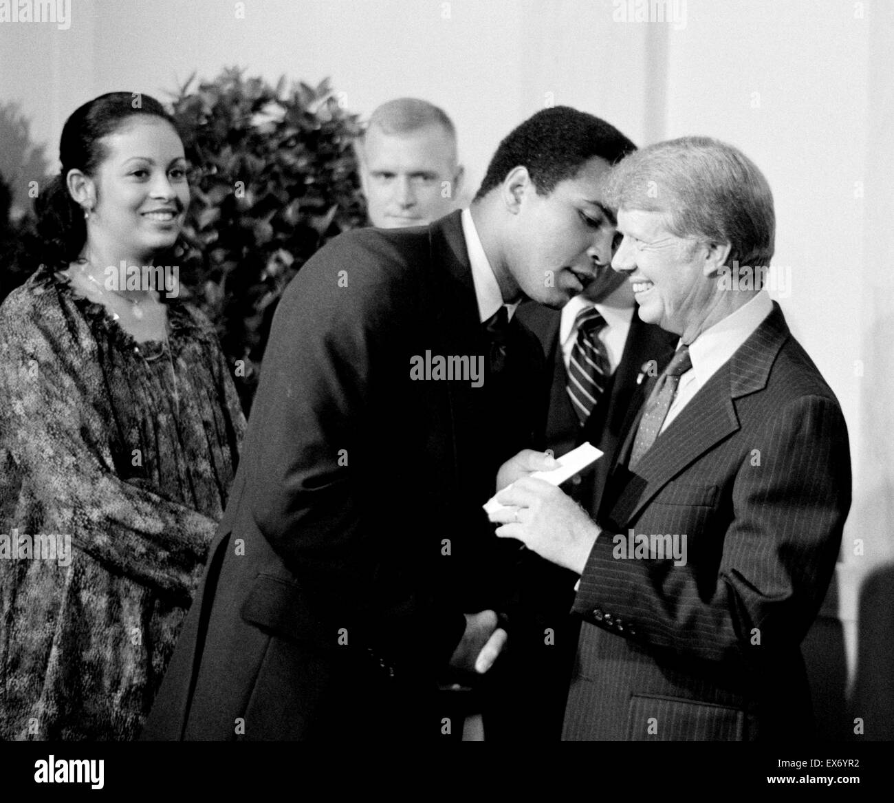 President Jimmy Carter greets Muhammad Ali at a White House dinner celebrating the signing of the Panama Canal Treaty, - Stock Image