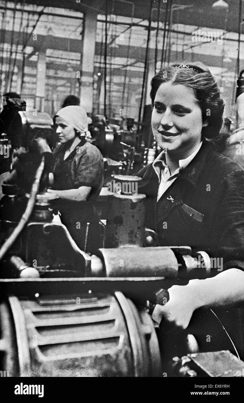 Women handling lathe in a factory in the USSR during world war two. - Stock Image