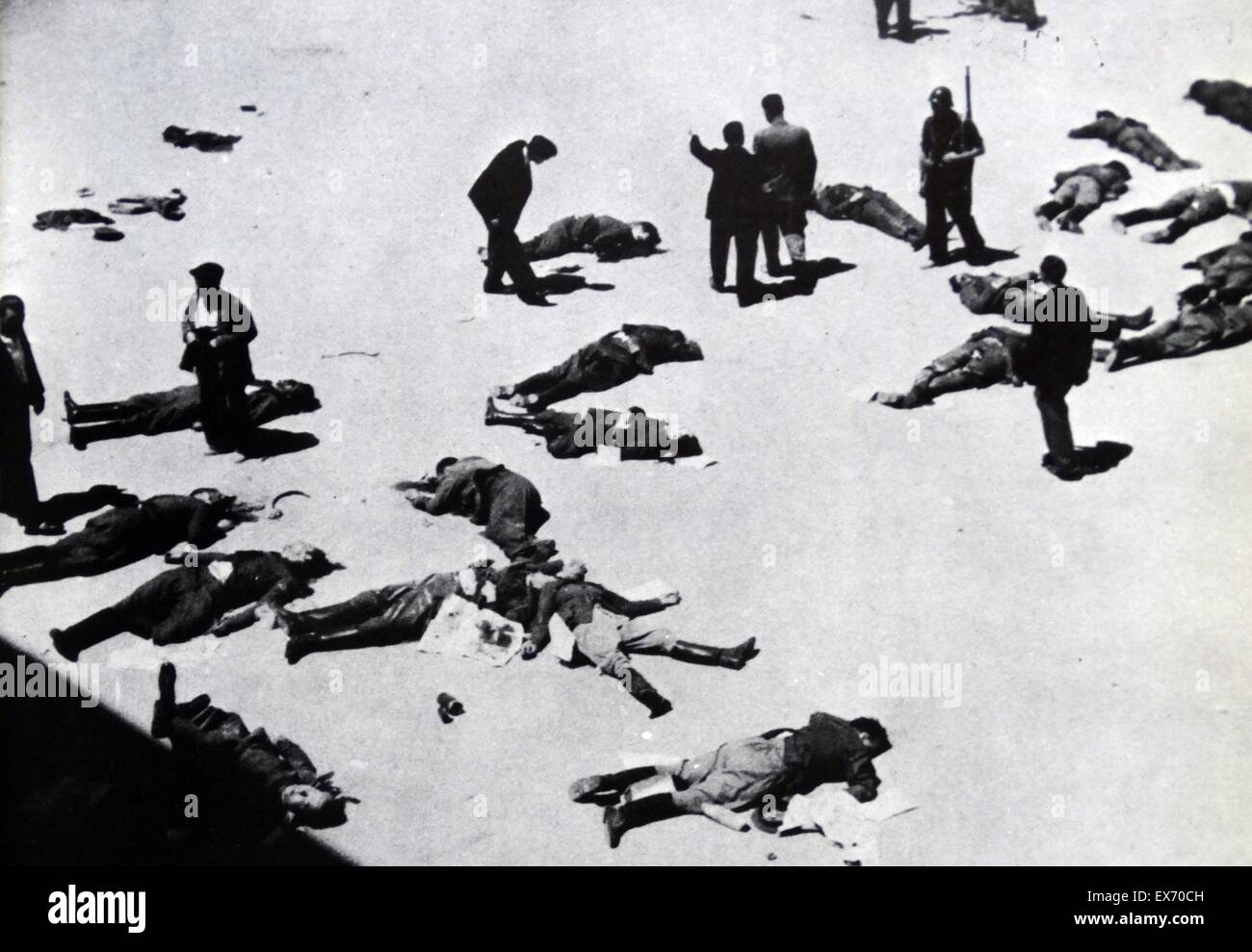 Anti-fascist militias survey their casualties after the capture of the Montaña barracks in Madrid from nationalist - Stock Image