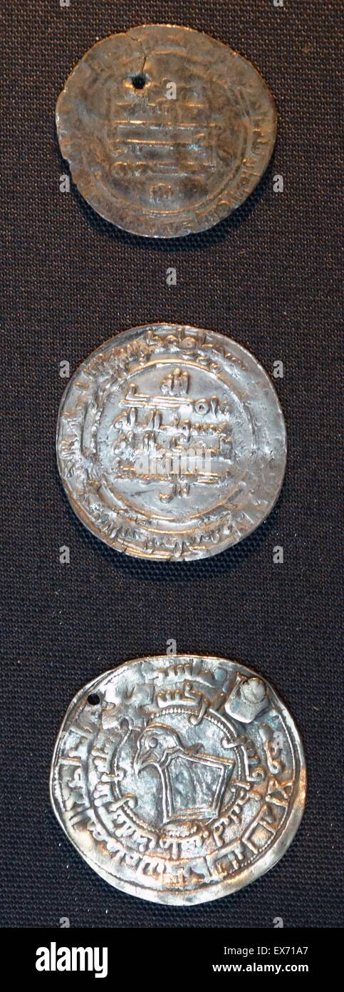 Islamic silver Coins. The left hand coin, minted in Merv (Turkmenistan) and found in Latvia, was used in a pendant. - Stock Image