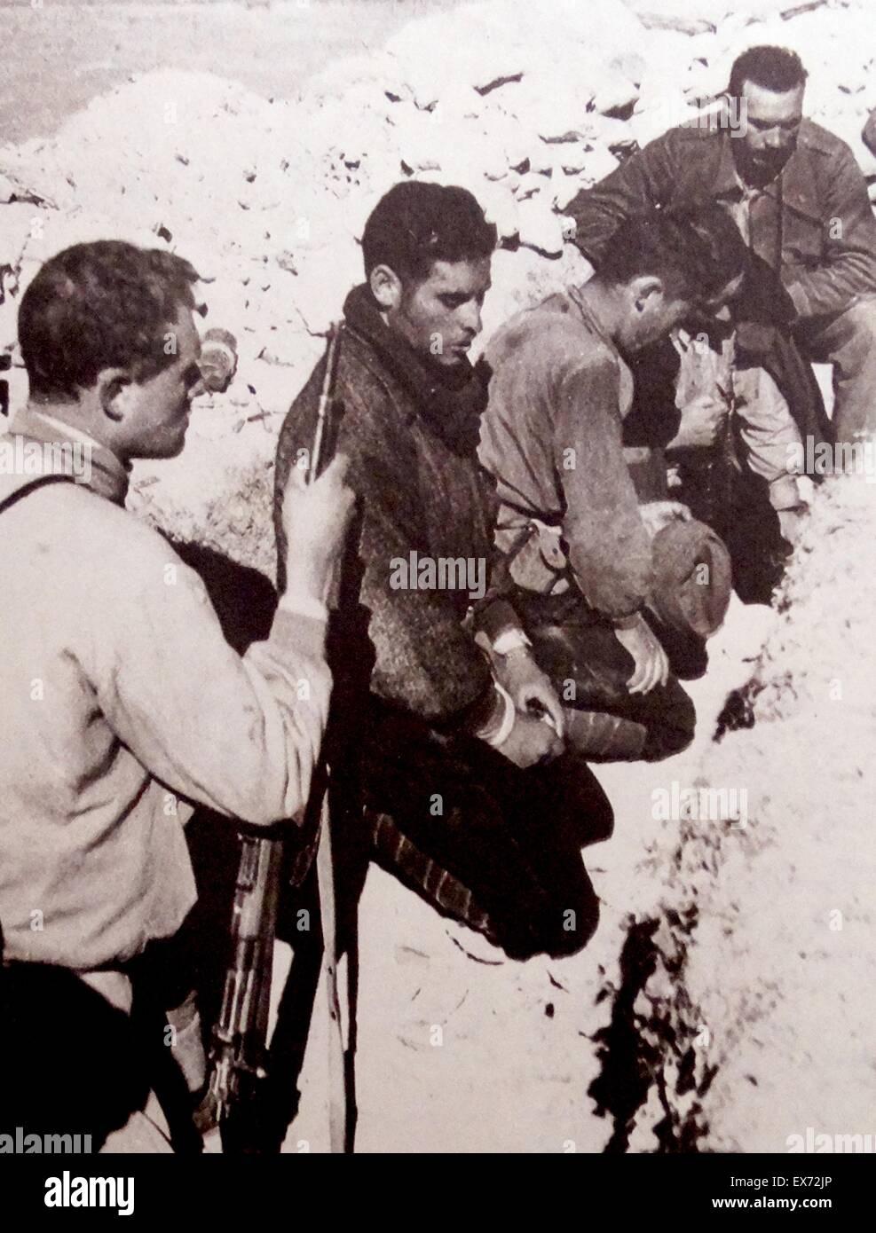 nationalist militia soldiers at prayer during the Spanish Civil War - Stock Image