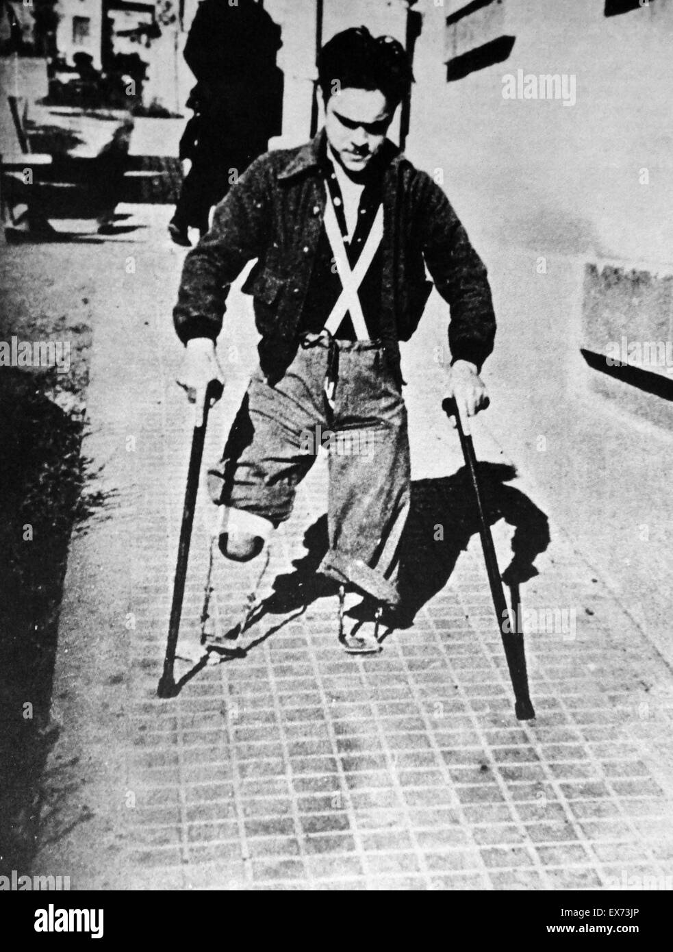 Double amputee war veteran, in a Spanish street during the Spanish Civil War - Stock Image