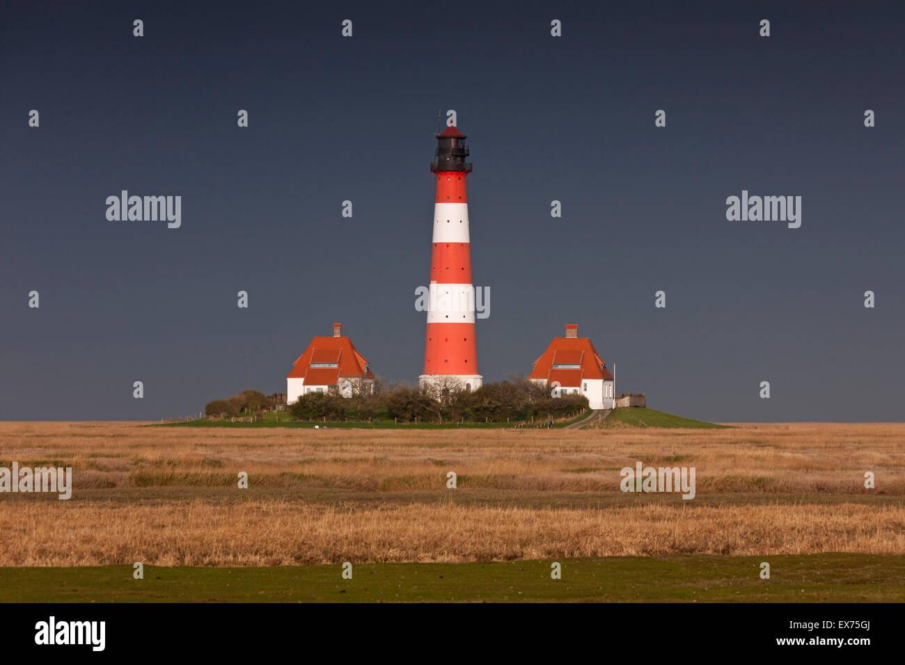 Dark rain cloud rolling in over lighthouse Westerheversand at Westerhever, Wadden Sea National Park, North Frisia, - Stock Image