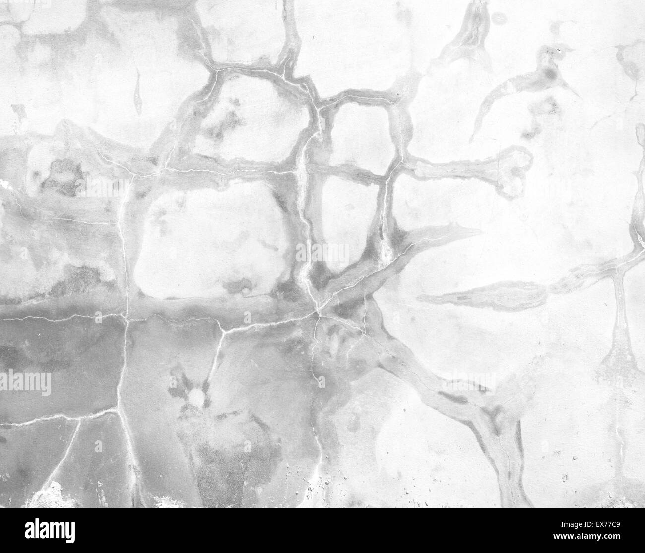 Polished plaster wall cracks construction background texture. - Stock Image