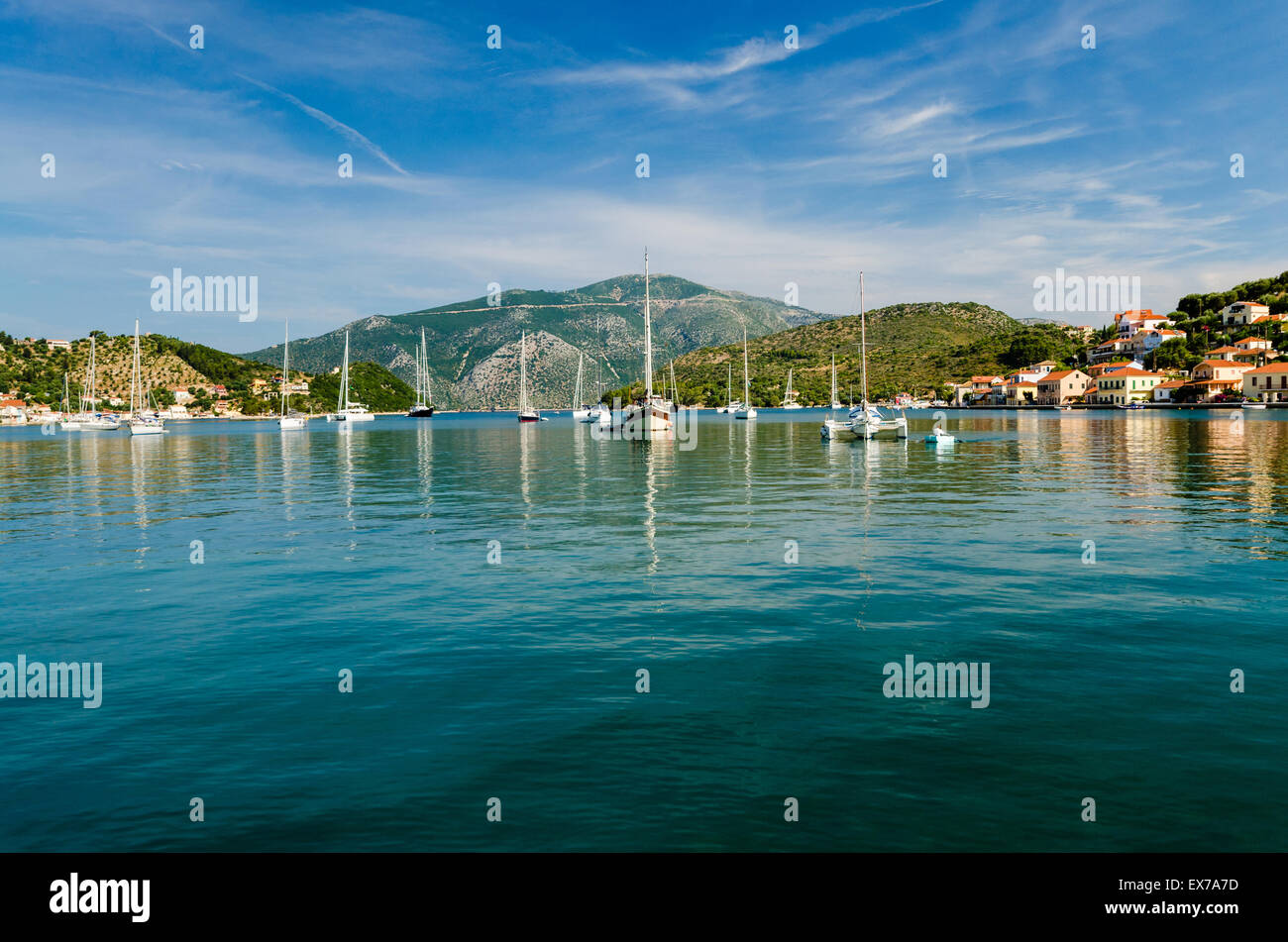 Boats and yachts moored up in Vathy harbour Ithaca - Stock Image