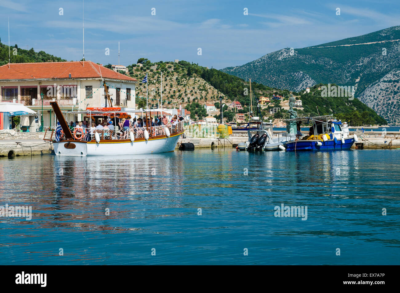 Pleasure boats with passengers in the harbour at Vathy - Stock Image