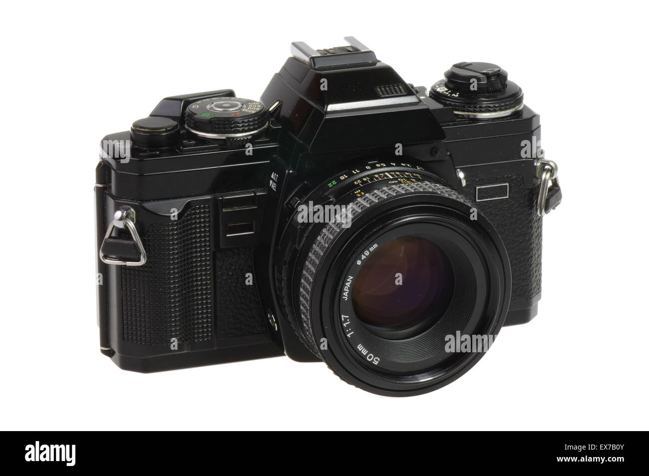 Old camera. Classic 135 format SLR camera on a white background - isolated - Stock Image