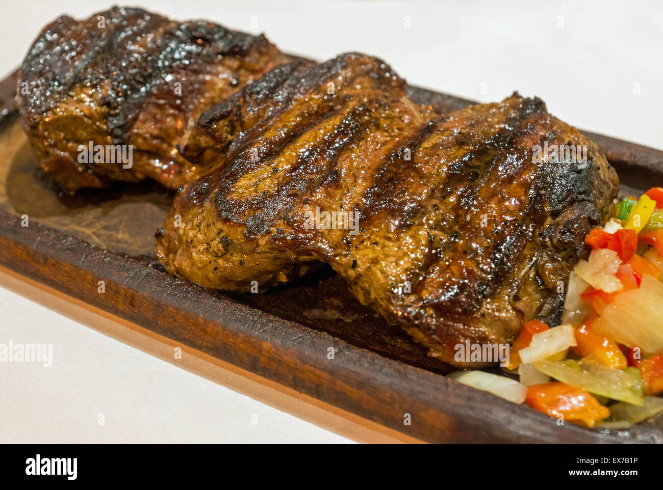 A delicious argentinean steak in a restaurant in Buenos Aires - Stock Image