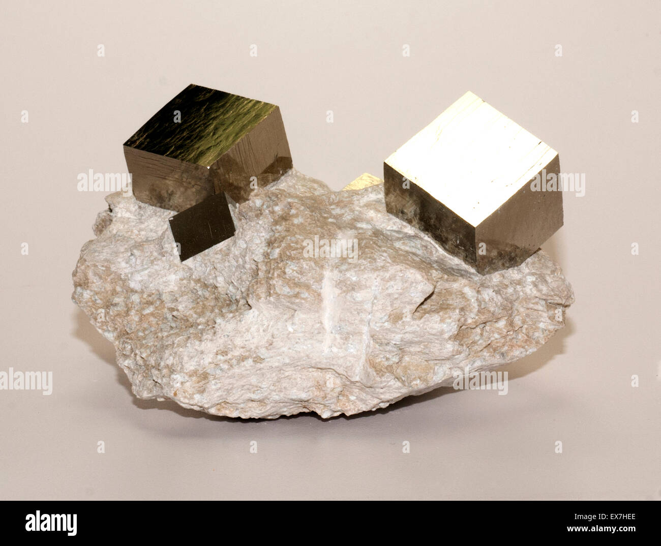 Iron pyrite cubic crystals in matrix - Stock Image