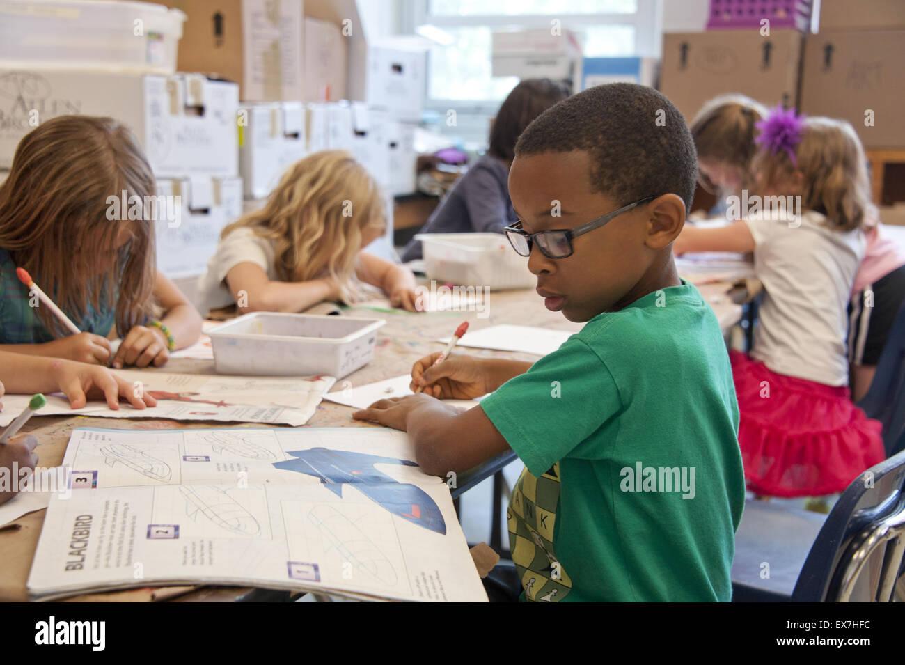 Afro-American minority student working in a school classroom in metropolitan, Atlanta, Georgia. - Stock Image