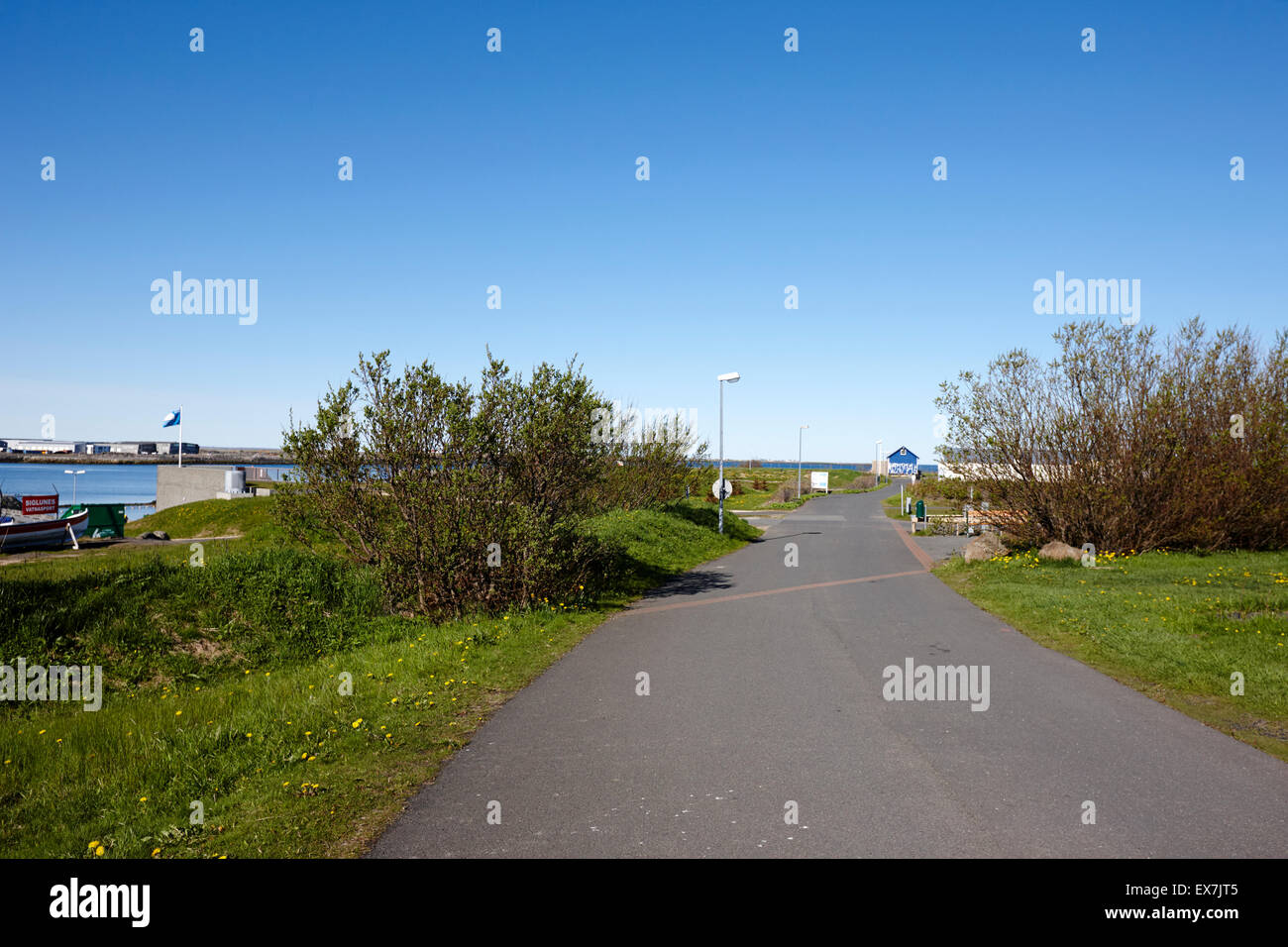 cycle path at nautholsvik artificial heated beach reykjavik iceland - Stock Image