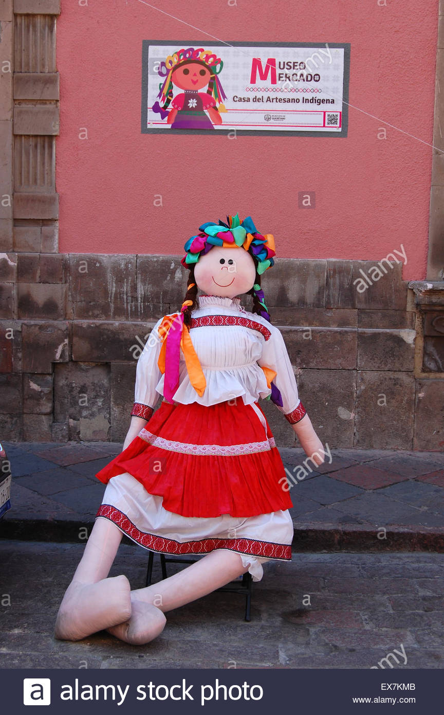 Closeup outdoor street shot large hand made  Mexican rag doll as display for indigenous Mexico artisans arts crafts - Stock Image