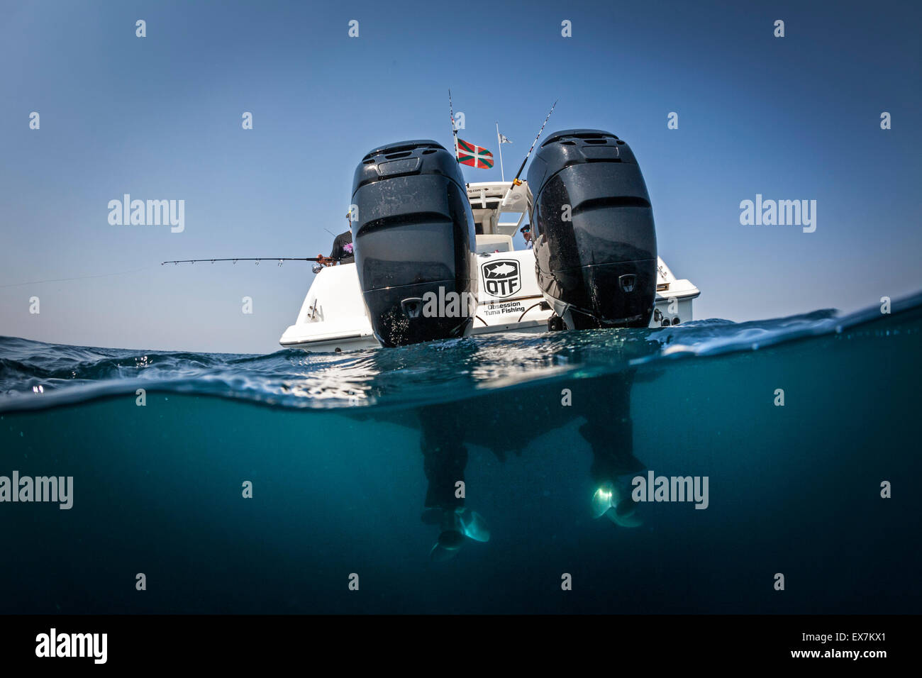 A Boston Whaler 320 Outrage speedboat with its 300 horsepower outboard Mercury motors. - Stock Image