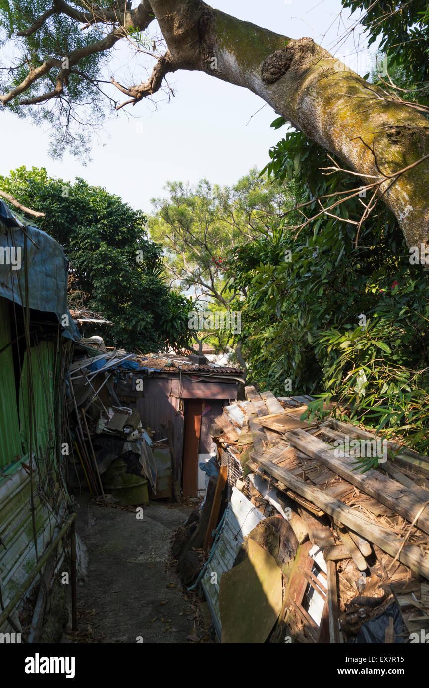 A narrow walking path on Cheung Chau island, Hong Kong. - Stock Image
