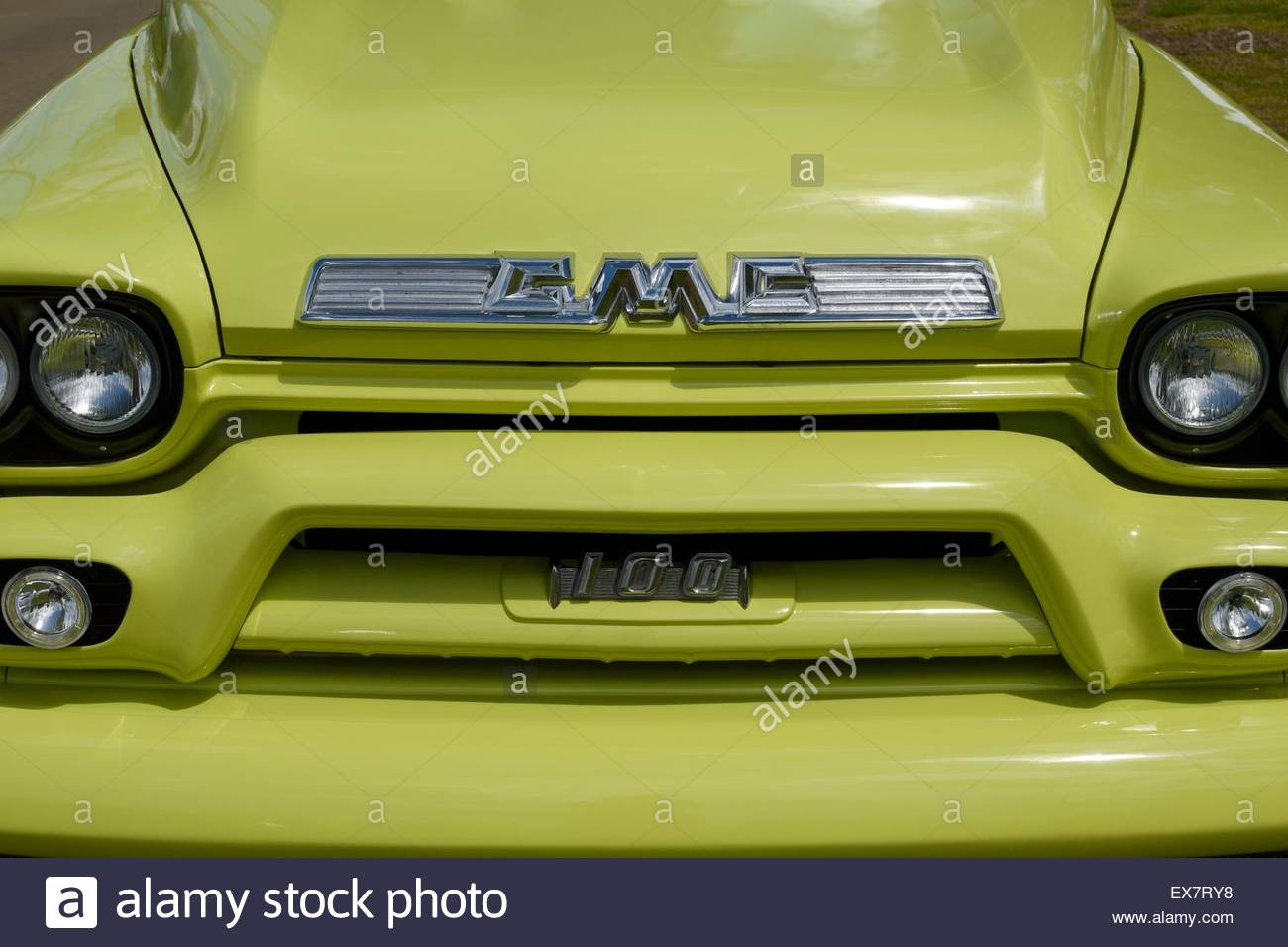 Close-up of a GMC (General Motors Company) badge, headlights and hood of a 1950's 100 pick-up truck - Stock Image