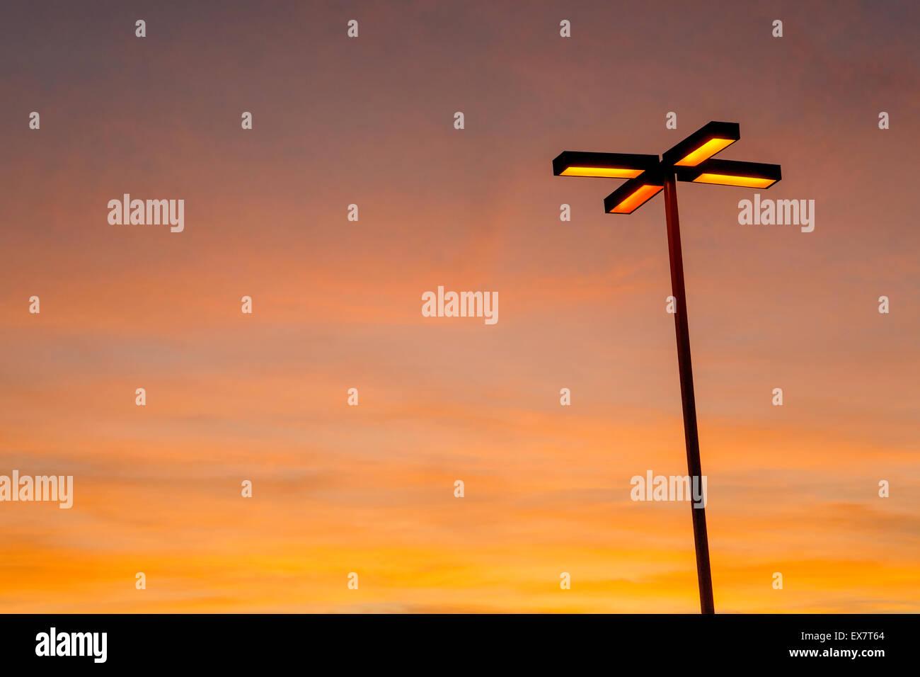 Light pole glowing at dusk, San Diego, California - Stock Image