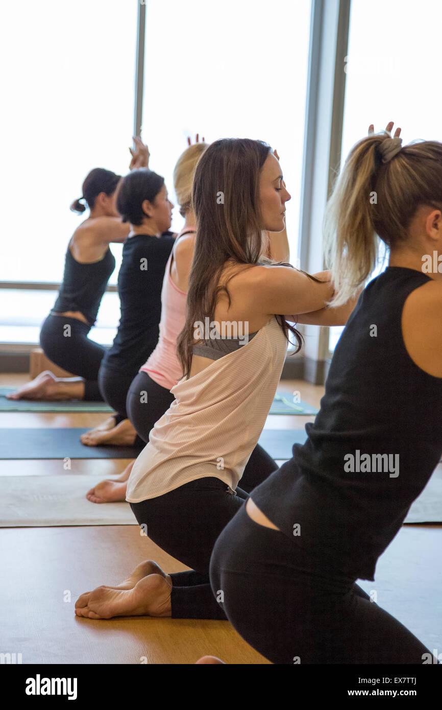 A group of women during a Yoga Vinyasa class - Stock Image