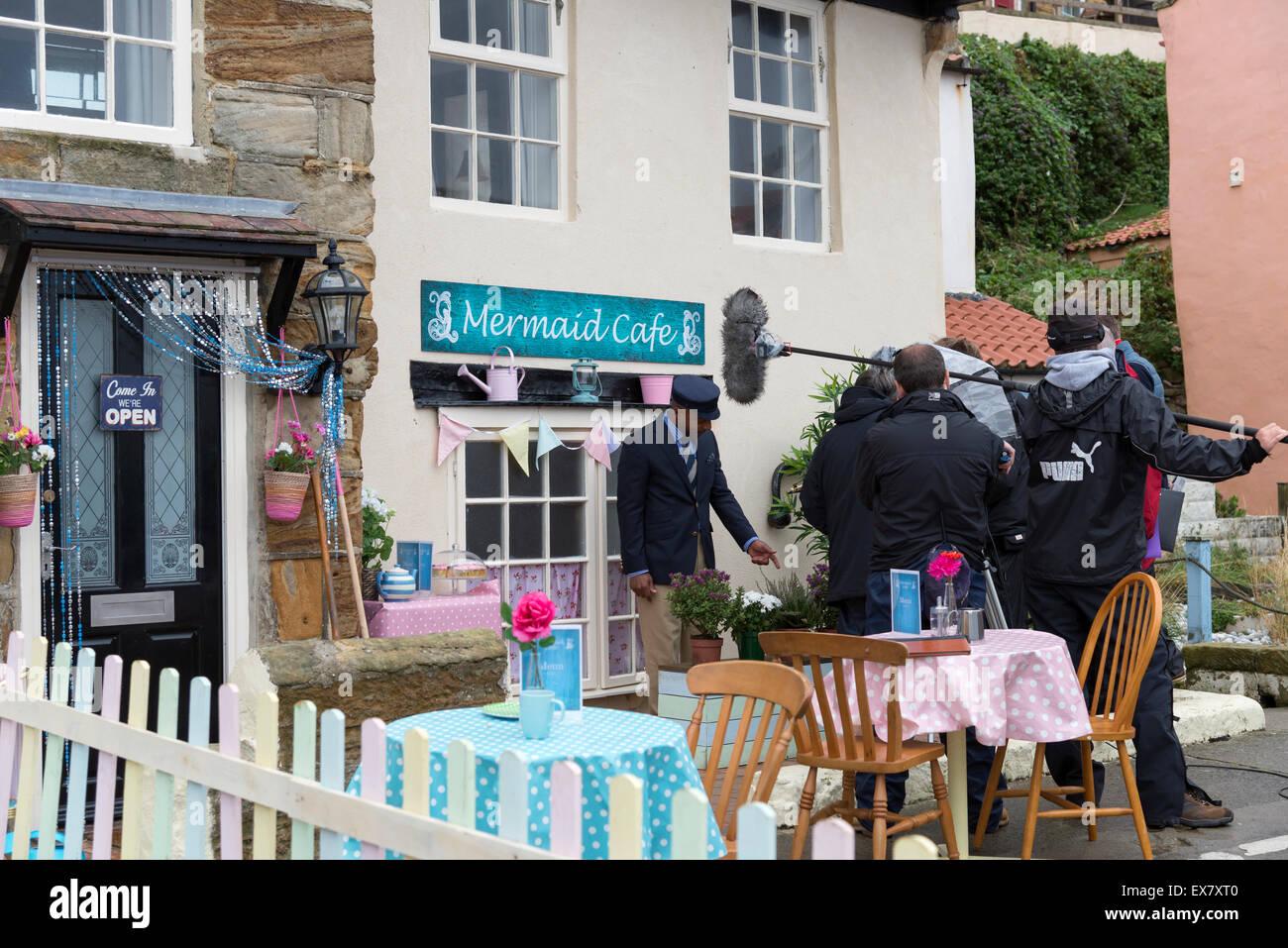 Film crew recording children's TV program starring Bernard Cribbins in the North Yorkshire village of Staithes - Stock Image
