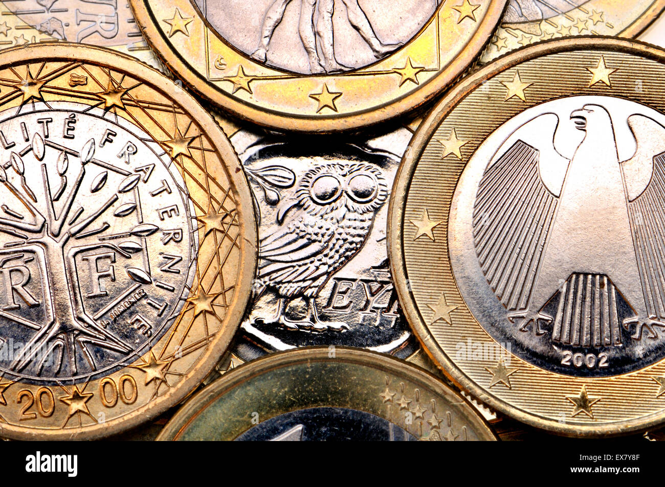 Greek Euro coin hiding behind other countries - Stock Image