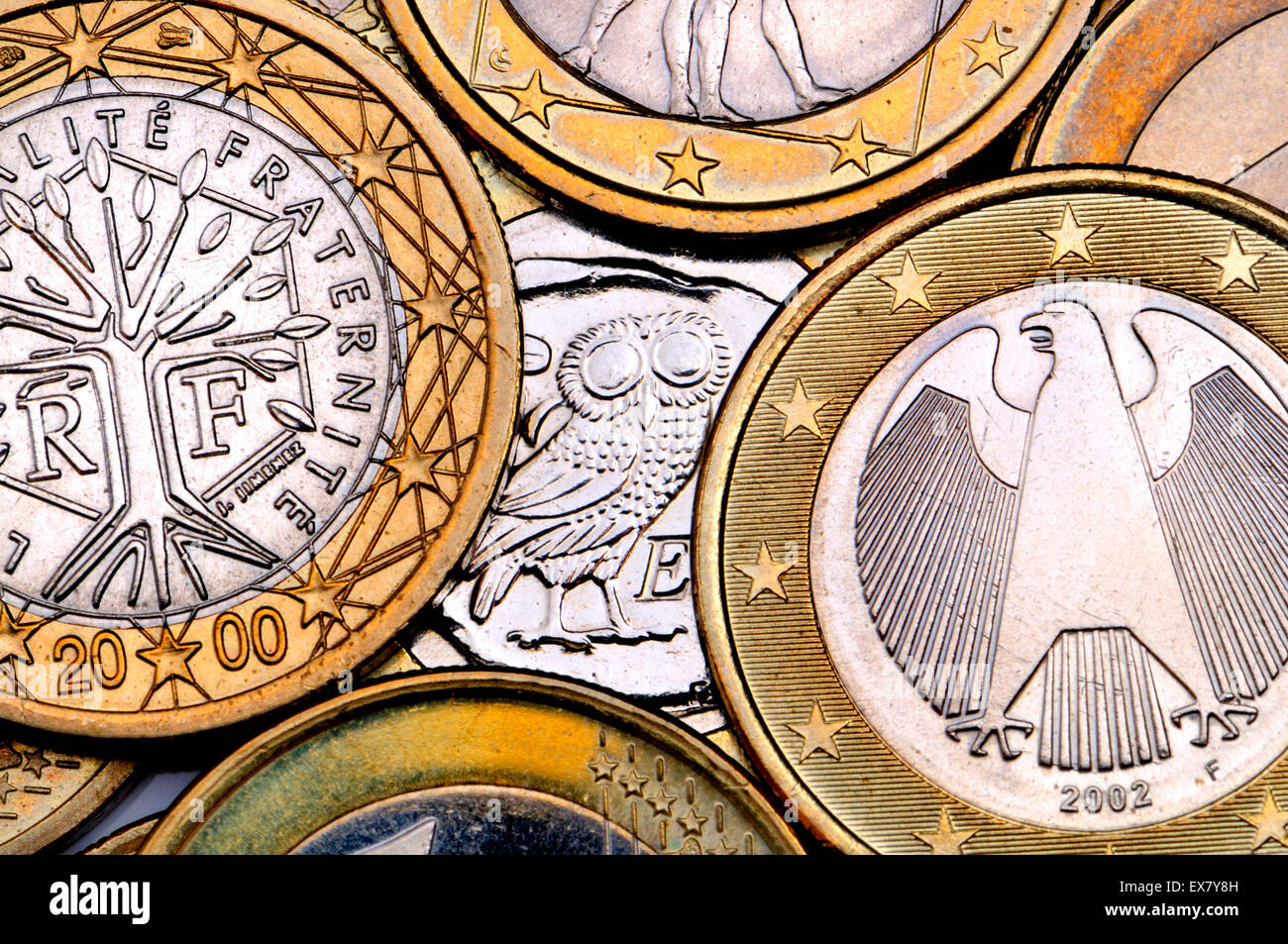 Greek Euro coin hiding behind other countries' - Stock Image