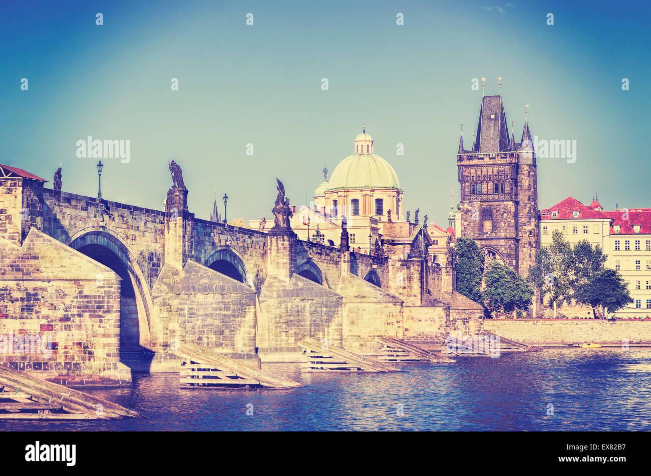 Retro instagram stylized picture of Prague, Charles bridge and Vltava river. - Stock Image