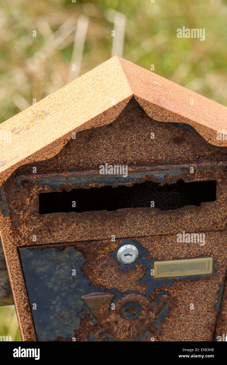 An old rusting letter box at Achmore on the Isle of Lewis, Outer Hebrides, Scotland, UK. - Stock Image