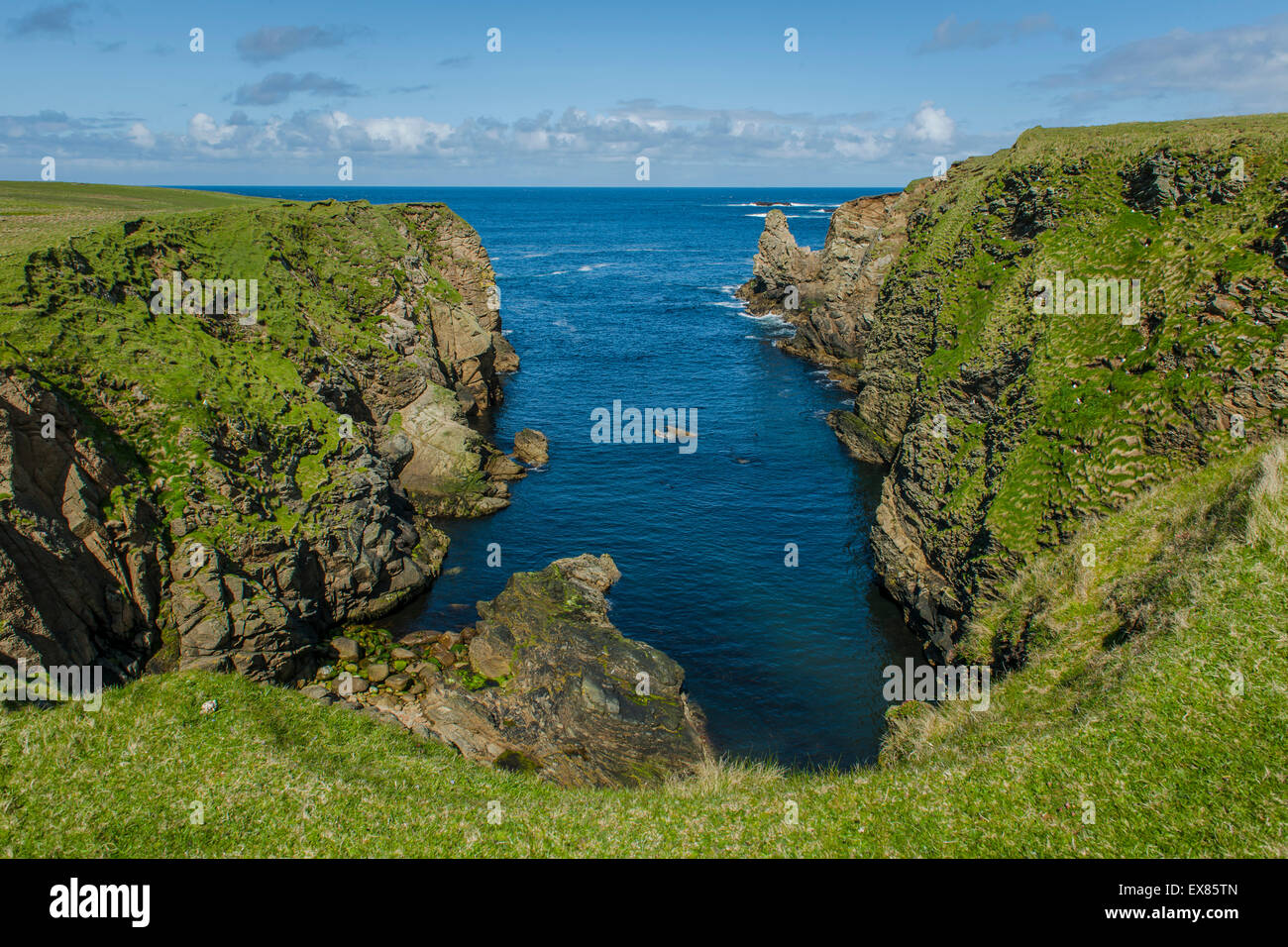 Coastline at the northernmost point of Great Britain, Unst, Shetland Islands, Scotland, United Kingdom - Stock Image