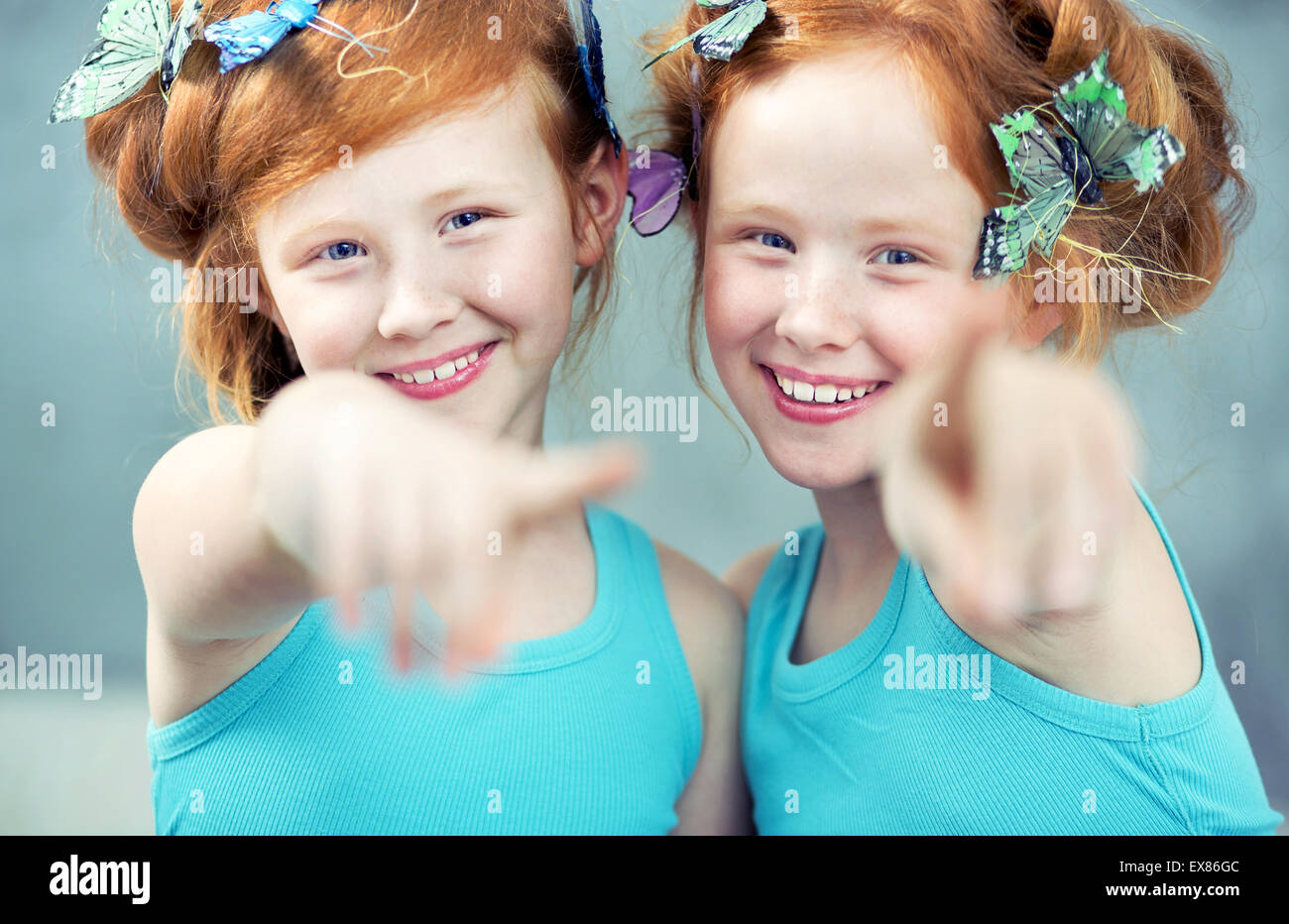 Portrait of two cheerful redhead twin sisters - Stock Image