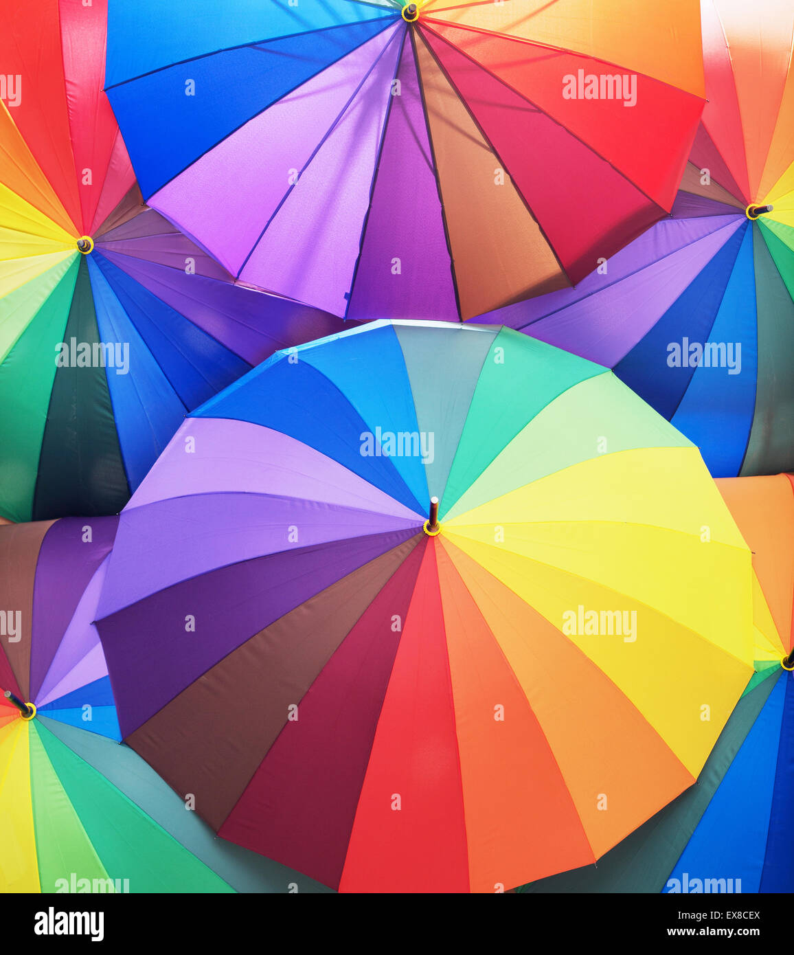 Bunch of colorful and vivid umbrellas - Stock Image