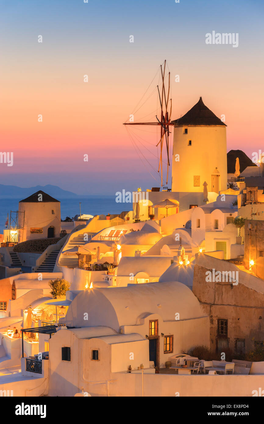 The town of Oia during sunset on Santorini, one of the Cyclades islands in Aegean Sea, Greece. - Stock Image