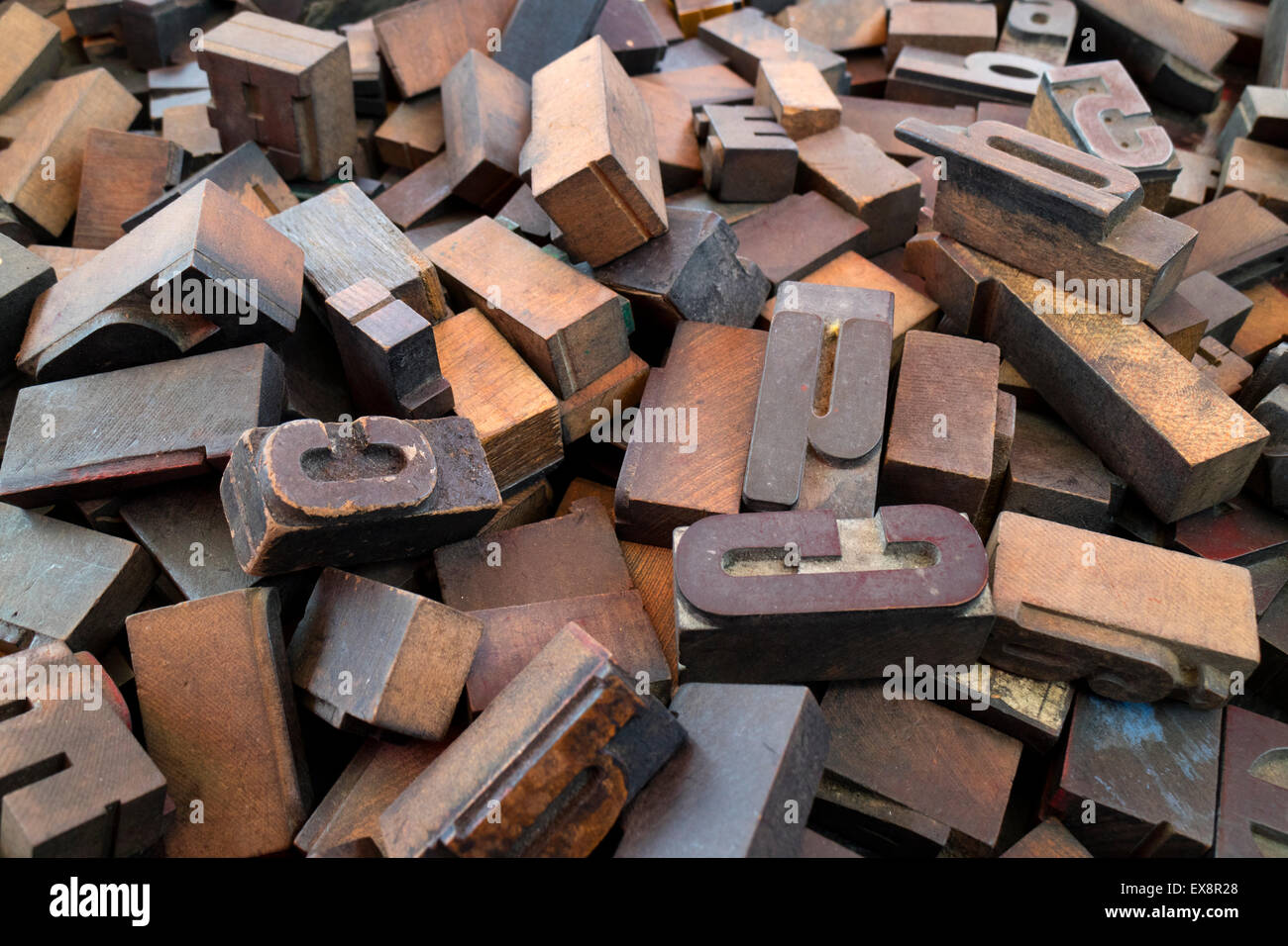 Heap of old carved wooden letters - Stock Image