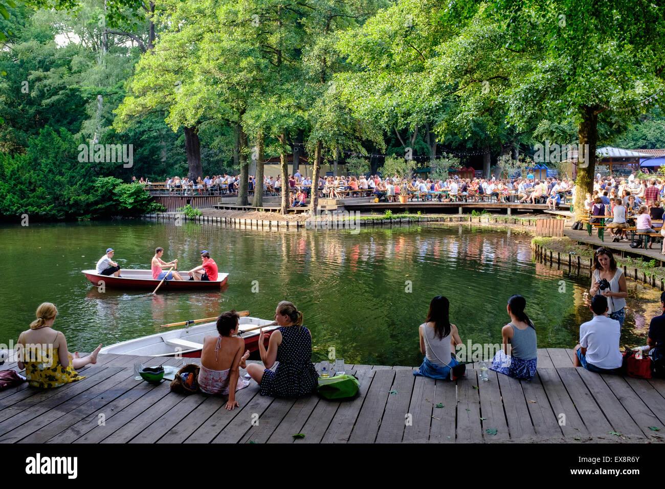 Busy beer garden in summer at Cafe am Neuen See in Tiergarten park in Berlin Germany - Stock Image