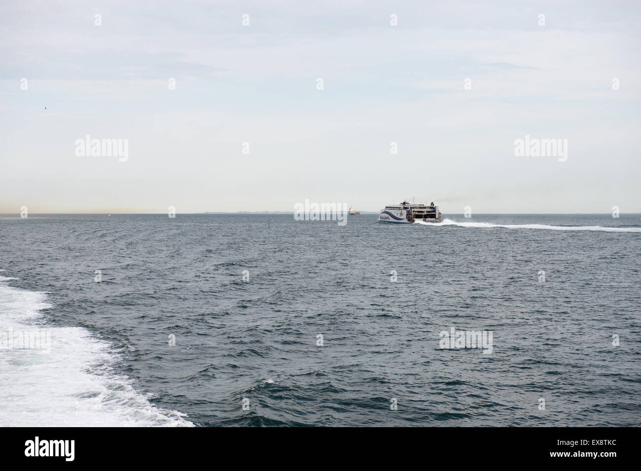 Mols-linien ferry on the sea running fast seen from the back - Stock Image