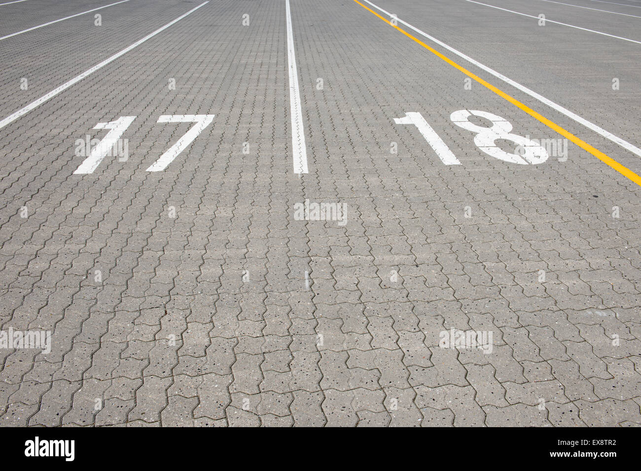 Ferry lane number 17 and 18 painted white on paving stone Stock Photo